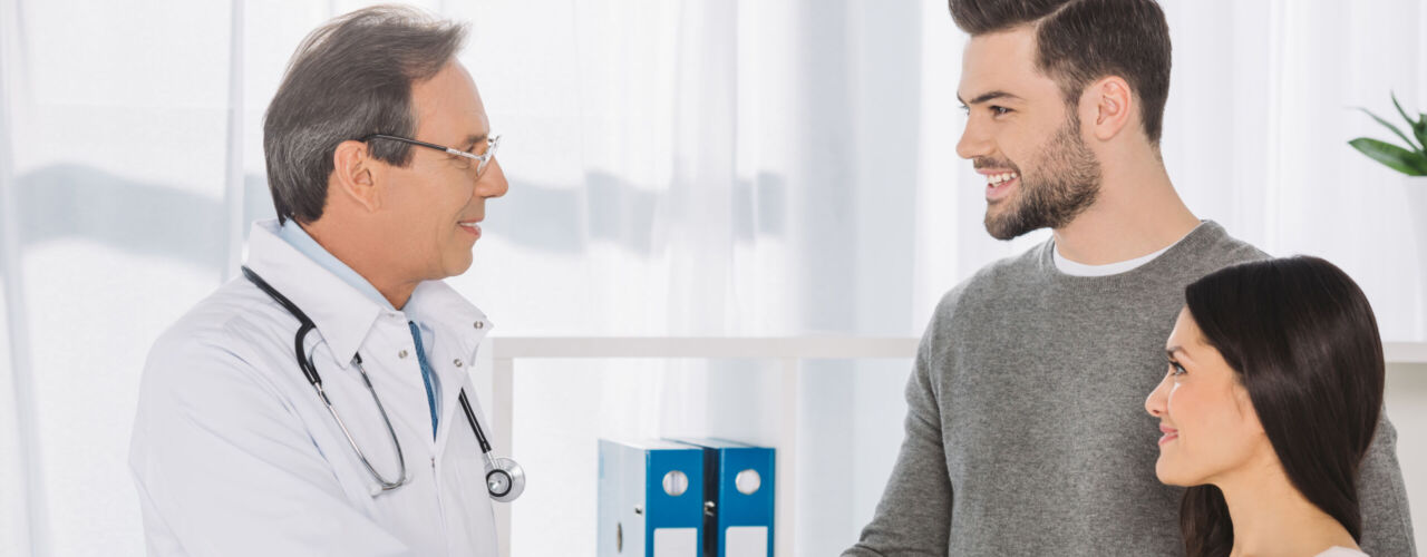 doctor and smiling patient shaking hands